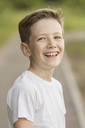 Portrait of cheerful boy at park - FSIF01827