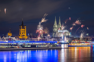 Germany, North Rhine-Westphalia, Cologne, Townhall, Gross Sankt Martin and Cologne Cathedral, New Year's Eve - WGF01166