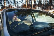 Beautiful woman in warm clothing driving car - FSIF01863