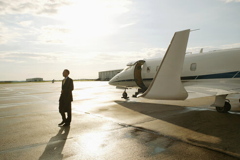 Businessman disembarking from a private airplane - FSIF02049