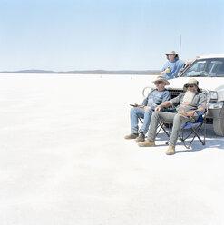 Three men and a car in a desert - FSIF02055