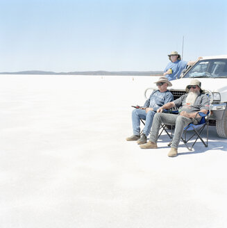 Three men and a car in a desert - FSIF02055