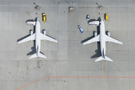 Aerial view of two airplanes on tarmac - FSIF02076