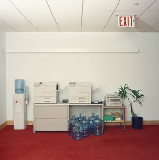 Photocopy machines next to water cooler in office - FSIF02091