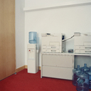 Photocopy machines next to water cooler in office - FSIF02094