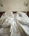 Unmade bed in hotel room - FSIF02106