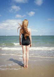 A woman standing at the edge of the sea - FSIF02424