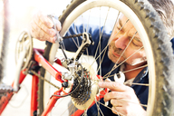 Man reparing bicycle - MAEF12533