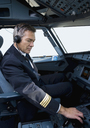A pilot in the cockpit of a commercial plane - FSIF02584