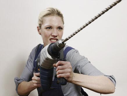 A woman holding a drill - FSIF02626