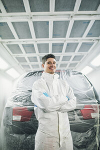 Portrait of smiling auto painter - RAEF01982