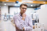 Portrait of serious businessman in factory - DIGF03405