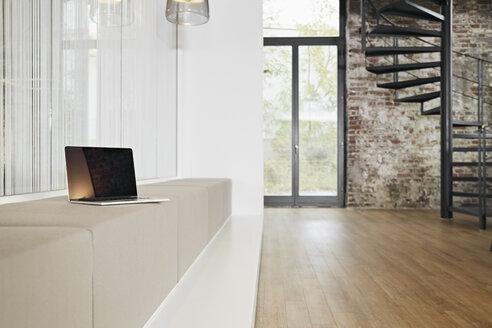 Laptop on bench in modern office - PDF01442