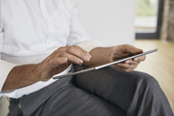Close-up of businessman using tablet - PDF01451