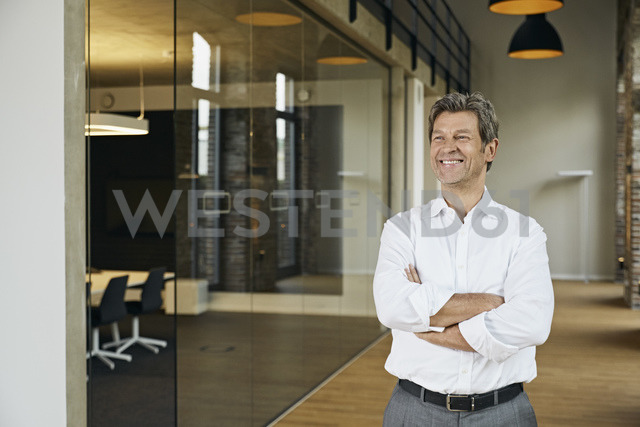 Portrait of smiling businessman in modern office - PDF01466