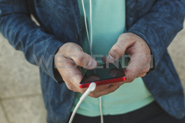 Close-up of man using smartphone - VPIF00368