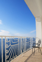 Croatia, Kvarner Gulf, balcony with empty chair - WWF04181