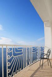 Croatia, Kvarner Gulf, balcony with empty chair - WWF04181