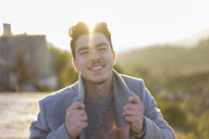 Portrait of smiling young man at twilight - AFVF00167