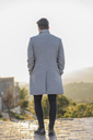 Back view of fashionable young man wearing grey coat - AFVF00170