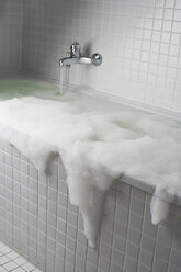 An overflowing bubble bath - FSIF02640