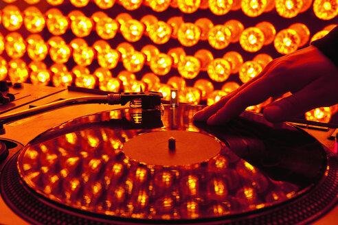 A DJ scratching a record at a nightclub - FSIF02682