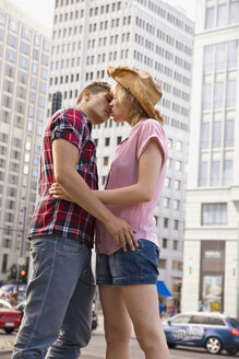 A young couple about to kiss in an urban setting - FSIF02727