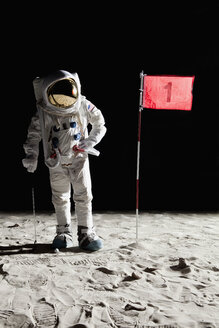 An astronaut on the moon standing next to number 1 hole flag - FSIF02763