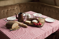 A simple rustic meal laid out on a set table - FSIF02784
