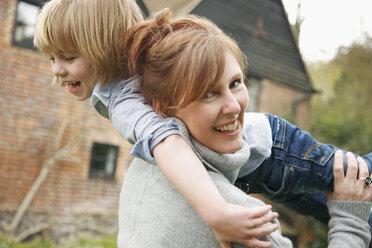 A mother holding her son over her shoulder - FSIF02828