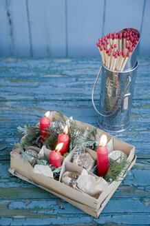 Carton with old baubles and red candles, matches - GISF00311