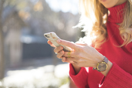 Close-up of woman using smartphone in a garden - AFVF00182