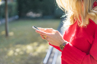 Close-up of woman using smartphone in a garden - AFVF00188
