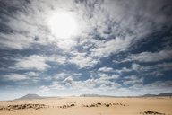 Spain, Canary Islands, Fuerteventura, Parque Natural de Corralejo, small person standing on dune - SIPF01938