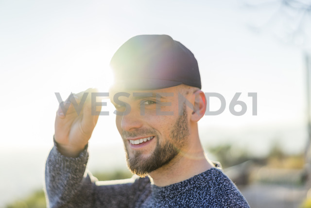 Portrait of smiling young man in backlight - AFVF00205