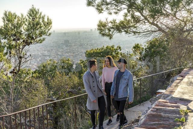 Three friends ascending a hill - AFVF00214