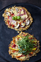 Cauliflower pizza garnished with rocket and bell pepper and champignons and cooked ham - CSF28947