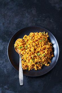 Bowl of bulgur wheat salad on dark ground - CSF28977