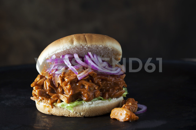 Burger with Jackfruit goulash in front of dark background - CSF28992