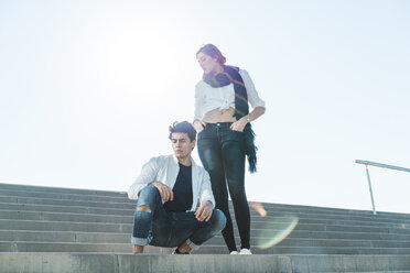 Portrait of stylish young couple on stairs outdoors - AFVF00257