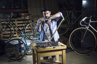 Portrait of mechanic in bicycle workshop - JSRF00032