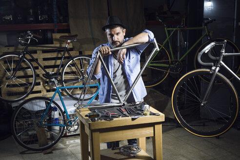 Portrait of mechanic in bicycle workshop - JSRF00032