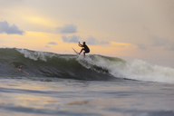 Indonesia, Bali, surfer surfing on wave - KNTF01013