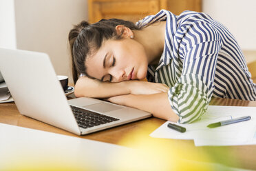 Young woman sleeping in front of her laptop at home - JHAF00020