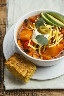 Vegan winter squash chili, served with cornbread. - HAWF00990