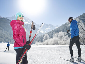 Austria, Tyrol, Luesens, Sellrain, two cross-country skiers in snow-covered landscape - CVF00156
