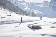 Austria, Tyrol, Luesens, Sellrain, two cross-country skiers in snow-covered landscape - CVF00159