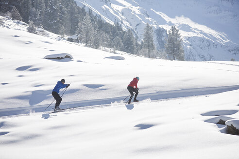 Austria, Tyrol, Luesens, Sellrain, two cross-country skiers in snow-covered landscape - CVF00162