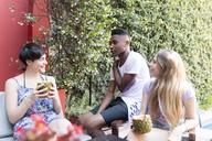 Happy friends having a drink outside - LFEF00057