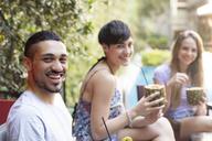 Portrait of happy friends having cocktails outside - LFEF00081